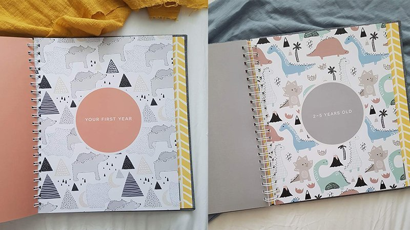 Inner pages of a Nordic style baby memory book with pastel coloured polar bears and dinosaurs