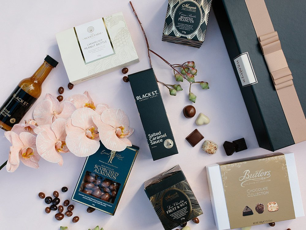 'Sweet Bites Hamper' from The Hamper Emporium - with luxurious black and gold gift box packaging and free delivery within Australia