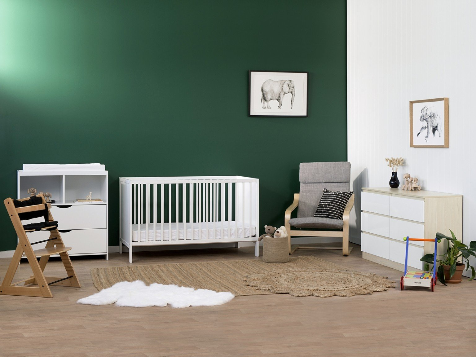 baby room with white cot and change table