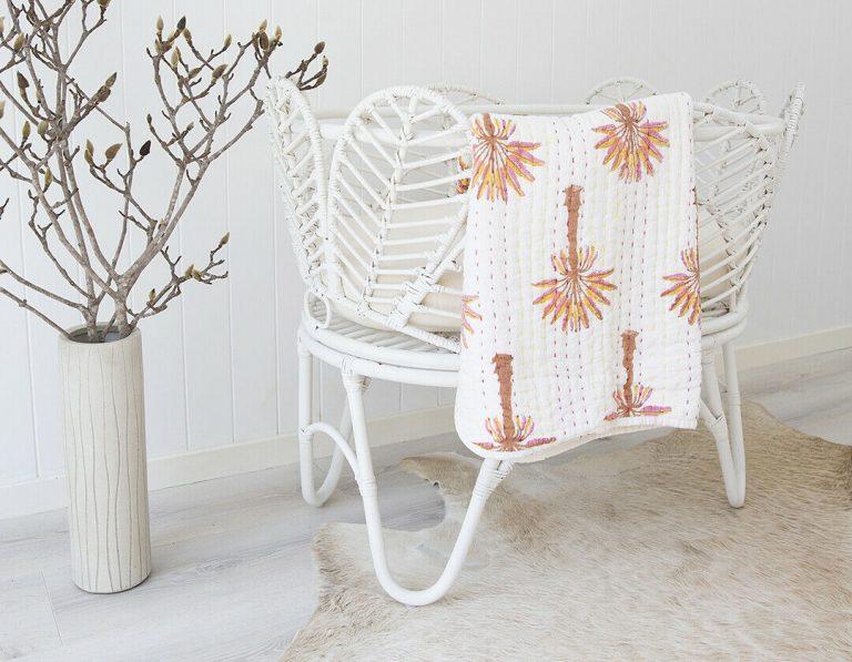 rattan bassinet in white