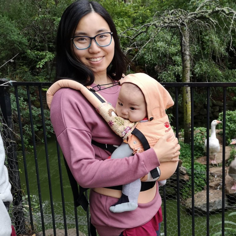 Front carry in the Manduca cotton and hemp baby carrier with hood canopy